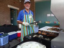 Our local Men's Shed member barbecuing sausages
