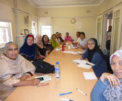 Women from many different cultures sitting at a table studying english
