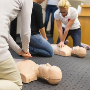 Image of Students doing CPR on Training aids.