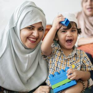 Muslim mum playing with her son