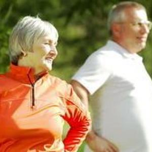 Older man and woman exercising outdoors