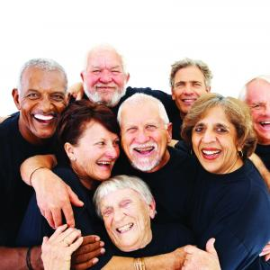 A group of seniors hugging and laughing