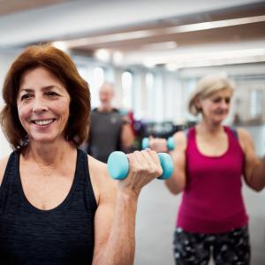 A group of over 50s lifting hand weights at the gym class