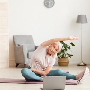 50+ women exercising online in her loungeroom