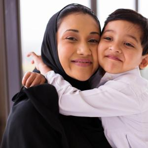 Muslim mum and son hugging