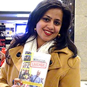 Picture of one of the movie stars holding a copy of the DVD
